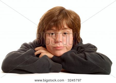 Young Teen Boy With Bored Expression