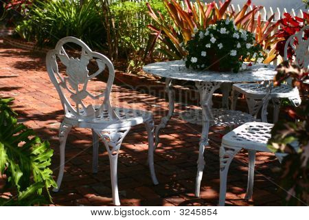 Chairs And Table In Garden