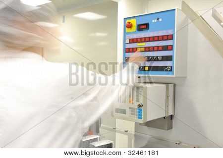 professional medical worker adjusting modern machine settings