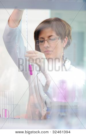 Femal lab scientist doing her research