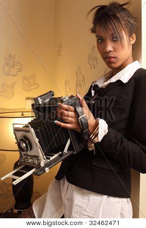 Beautiful Female Holding Antique Camera