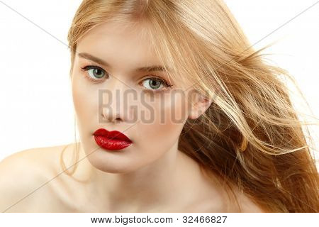 Beautiful woman face closeup with long blond flying hair and vivid red lipstick. Isolated on white background