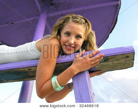 Young Cheerful Woman Lying Under Beach Umbrella