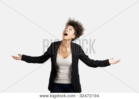 Business woman trying to catch something falling from the sky, isolated over a gray brackground