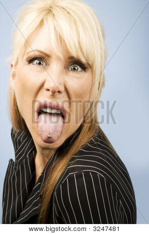 Woman Sticking Out Her Pierced Tongue