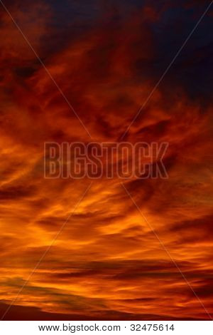 Dramatic sunset sky with clouds glowing red