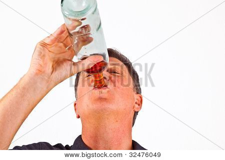 Man Drinking Alcohol Out Of The Bottle