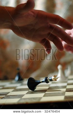 Playing chess game. defeating the King.