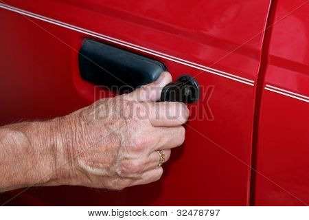 Using a key to unlock a car door