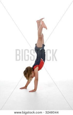 Little Girl Doing A Handstand