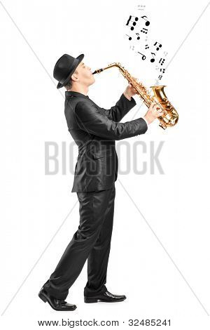 Full length portrait of a male playing on saxophone and notes coming out isolated against background