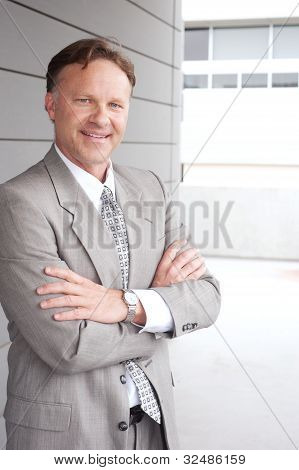 Portrait Of A Confident Mature Businessman Standing Outside