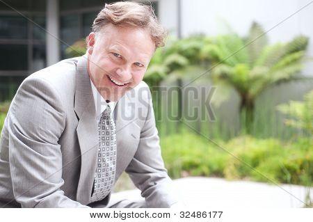 Portrait Of A Confident Mature Businessman Sitting Outside