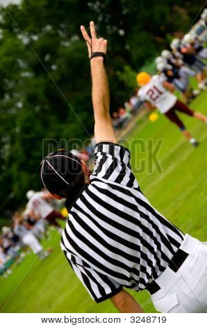 American Football Referee With Hands Up