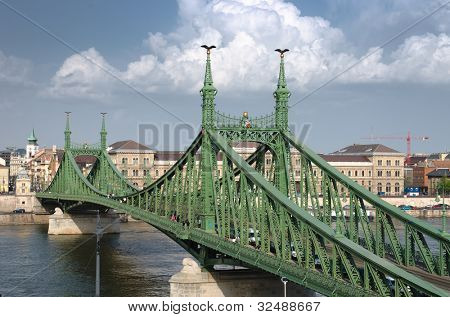 the Liberty Bridge (sometimes Freedom Bridge) in style Art Nouveau connects Buda and Pest across the River Danube in Budapest