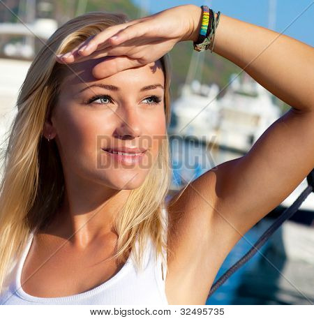 Beautiful teen girl sailing, young woman enjoying summer travel, close-up portrait on happy smiling female face, summer cruise holidays, European girl tourist traveling in sail boat around the world