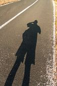 Human Shadow On The Road. Shadow Of A Man On Asphalt In The Morning Sun. Sunrise On The Road. Shadow poster