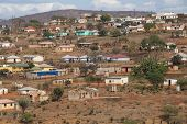 Housing And Huts Scattered Informally On Hill In Rural South Africa poster