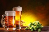 stock photo of keg  - Still life with a keg of beer and hops - JPG