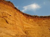 stock photo of loamy  - clay hill scenery after erosion and excavation - JPG