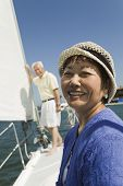 image of early 50s  - Smiling Woman and Husband on Sailboat - JPG