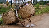 stock photo of indian money  - All around Asia you will find bicycles overloaded with too much cargo and just simple baskets.