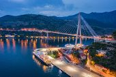 Aerial View Of Cruise Ship At Harbor And Beautiful Bridge At Night. Landscape With Ships And Boats I poster