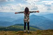 Girl Traveling In Mountains Alone, Standing With Hands Up Achieving The Top, Welcomes A Sun. Walking poster