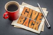 give back inspirational word abstract in vintage letterpress wood type ona napkin with a cup of coff poster