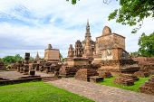 Sukhothai Historical Park, Temple Ruins Of Wat Mahathat In The Sukhothai Historical Park, Thailand. poster