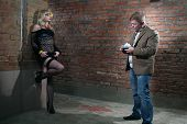 stock photo of prostitution  - client and prostitute in gateway - JPG