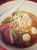 Delicious Noodles With Pork And Pork Balls With Soup In White In Thai Style Food. Thai Peoples Call poster