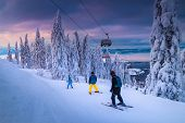 Beautiful Snow Covered Trees And Winter Ski Resort With Fast Ski Lift. Active Skiers Skiing Downhill poster