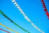 Colorful Flag Ribbons In Sunny Blue Sky. Festival Flag Decor. Summer Day Outdoor. Optimistic Skyscap poster