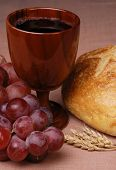 foto of communion-cup  - Communion elements of grapes cup bread and wheat - JPG