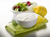 stock photo of yogurt  - white yogurt dressing for salad - JPG