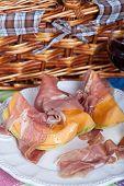 foto of nic  - Fresh cantaloupe melon with italian Parma ham - JPG