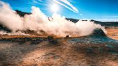 Steaming Cone In Hverir Geothermal Area With Boiling Mudpools And Steaming Fumaroles In Iceland  Loc poster