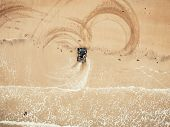 Extreme Sport On Quad Bike Beach Of Sea Leaves Traces. Aerial Top View poster