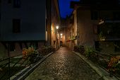 Fragment Of A Street Of The Old City. Annecy. France. Early Morning, Street Lamps Burn. The Sky Is D poster