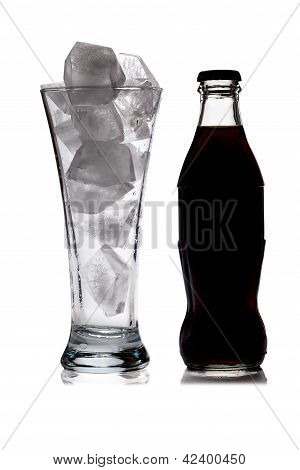 Silhouette Of Glass With Ice And Cola Bottle On White