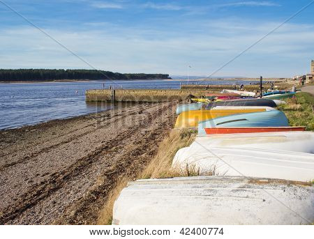 Upturned boats on beach
