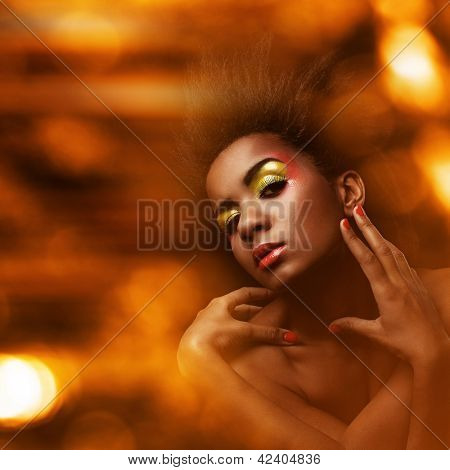 Beautiful black woman with glossy wet makeup