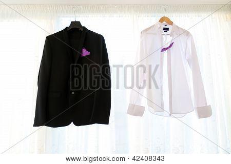 Suit Jacketand Shirt Hanging On A Hanger