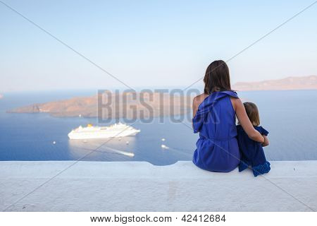 Family of two sit on the roof and watch amazing view