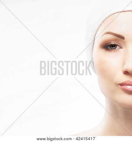 Spa styled portrait of young and beautiful woman isolated on white