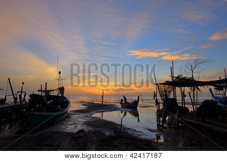 Silhouette Fisherman Is Standing On Fishing Boat