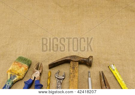 Different Retro Construction Work Tools On Linen