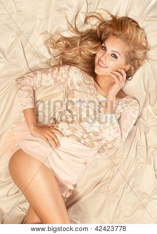 Wonderful Blonde Young Smiling Woman Lying, Looking At Camera.