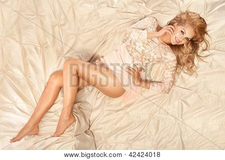 Conceptual Photo Of Beautiful Young Blonde Cheerful Woman Lying In Big Bed, Relaxing.
